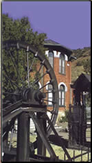 Historical buildings and mining equipment.